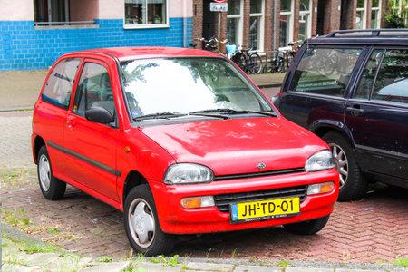 subaru: AMSTERDAM, NETHERLANDS - AUGUST 10, 2014: Motor car Subaru Vivio in the city street. Editorial