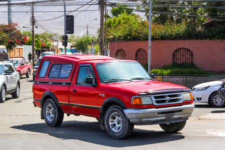 utilitarian: COPIAPO, CHILE - NOVEMBER 14, 2015: Red pickup truck Ford Ranger in the city street.
