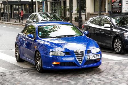 alfa: PARIS, FRANCE - AUGUST 8, 2014: Motor car Alfa Romeo GT in the city street.