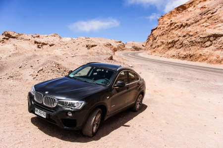 crossover: ANTOFAGASTA, CHILE - NOVEMBER 15, 2015: New black crossover BMW F26 X4 in the Atacama desert.
