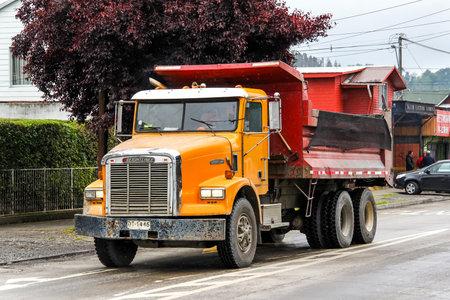 freightliner: VILLARRICA, CHILE - NOVEMBER 20, 2015: Dump truck Freightliner FLD in the town street.