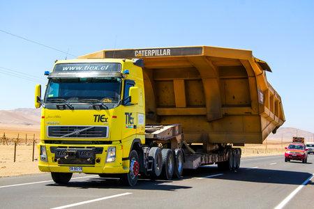 cargo transport: ATACAMA, CHILE - NOVEMBER 18, 2015: Heavy trailer truck Volvo FH at the Pan-American Highway.