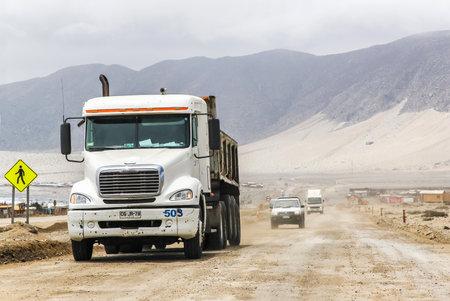 freightliner: ATACAMA, CHILE - NOVEMBER 14, 2015: Semi-trailer truck Freightliner Columbia at the gravel interurban freeway through the Atacama desert. Editorial