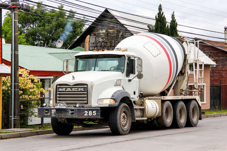 VILLARRICA, CHILE - NOVEMBER 20, 2015: Concrete mixer truck Mack Granite in the town street. 報道画像