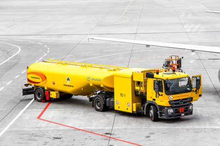 MOSCOW, RUSSIA - SEPTEMBER 9, 2013: Yellow fuel tank truck Mercedes-Benz Actros at the air field of the Vnukovo international airport. Редакционное