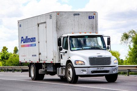 freightliner: BIO-BIO, CHILE - NOVEMBER 23, 2015: Cargo truck Freightliner Business Class at the interurban freeway.