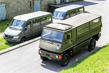 flatbed truck: GOTTHARD PASS, SWITZERLAND - AUGUST 5, 2014: Swiss army troops carrier Bucher Duro and vans Mercedes-Benz Sprinter at the Alpine road.