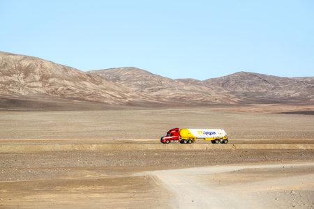 freightliner: ANTOFAGASTA, CHILE - NOVEMBER 14, 2015: Semi-trailer truck Freightliner Century Class at the interurban freeway through the Atacama desert. Editorial