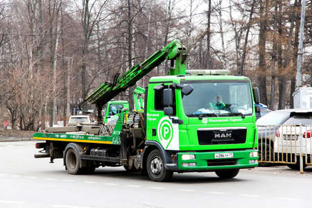 rescue service: MOSCOW, RUSSIA - MARCH 8, 2015: Green rescue service truck MAN TGL in the city street.