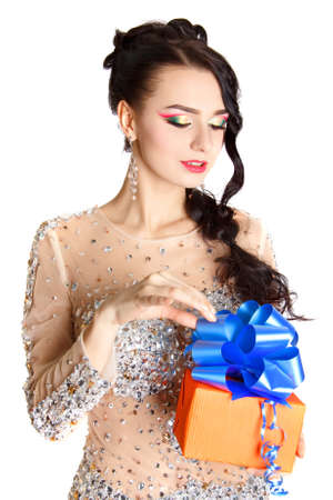 female christmas: Portrait of a beautiful young woman with a bright gift isolated over white background