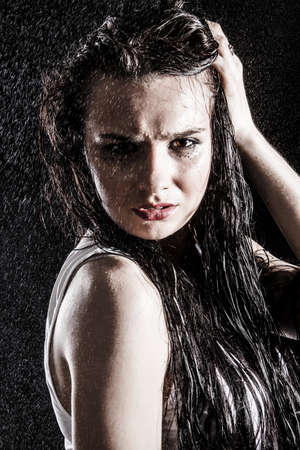 impassioned: Wet sexy woman covered with water drops over black background