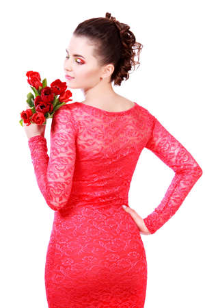 Beautiful young woman in a red evening dress isolated over white background