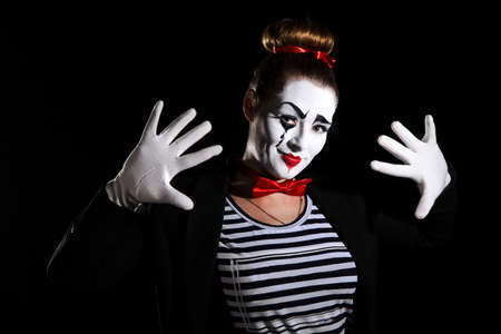 mime: Female mime artist over black background