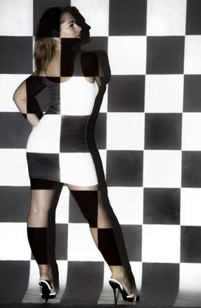 dazzled: Beautiful young woman covered with black and white small squares