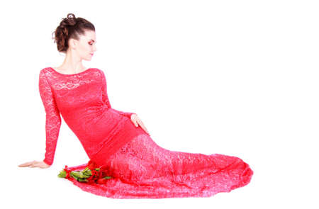 red evening: Beautiful young woman in a red evening dress isolated over white background