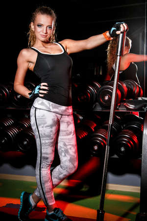 staying fit: Beautiful young woman in a gym