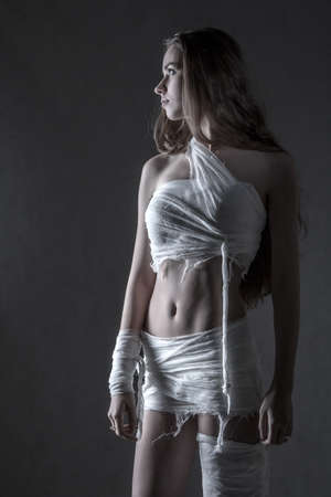 uncombed: Young woman with a bandage dressings on her body