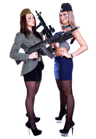 Two women in the marine and the military uniforms with the assault rifles isolated over white background Stock Photo