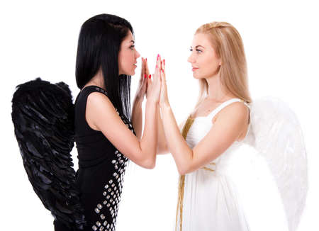 compatibility: Beautiful young angel playing pat-a-cake with a black angel Stock Photo