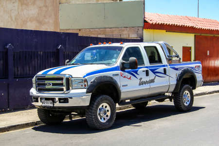 farm duties: CALAMA, CHILE - NOVEMBER 16, 2015: Pickup truck Ford F-350 in the city street.