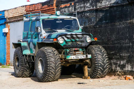 customized: NOVYY URENGOY, RUSSIA - JUNE 20, 2016: Customized off-road vehicle UAZ 3151 in the town street. Editorial