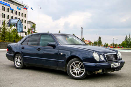 evening class: NOVYY URENGOY, RUSSIA - JULY 31, 2016: Motor car Mercedes-Benz W210 E240 in the city street. Editorial