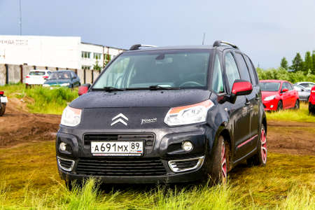 NOVYY URENGOY, RUSSIA - JUNE 25, 2016: Motor car Citroen C3 Picasso at the countryside. Editorial