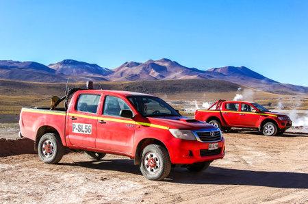 ANTOFAGASTA, CHILE - NOVEMBER 16, 2015: Pickup trucks Toyota Hilux and Mitsubishi L200 in the Atacama desert. Editorial