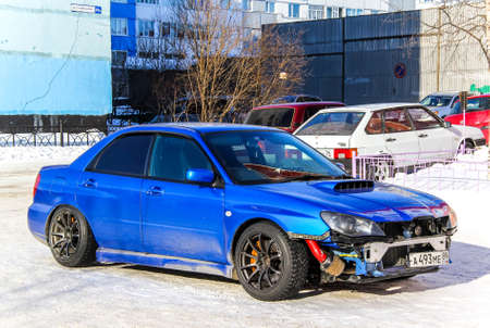 supercharged: NOVYY URENGOY, RUSSIA - APRIL 6, 2013: Motor car Subaru Impreza in the city street. Editorial