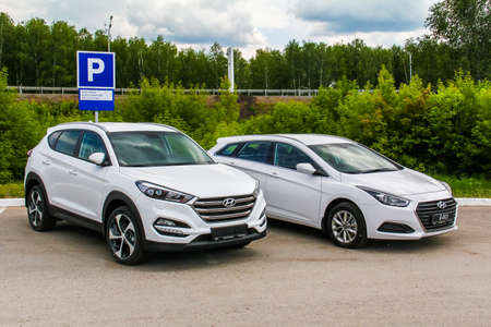 UFA, RUSSIA - JUNE 12, 2016: Brand new motor cars Hyundai Tucson and Hyundai i40 at the parking.