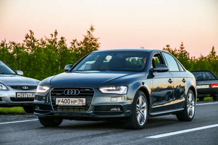 a6: NOVYY URENGOY, RUSSIA - JUNE 17, 2016: Motor car Audi A6 at the interurban road at the background of a sunset. Editorial