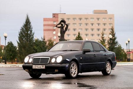 evening class: NOVYY URENGOY, RUSSIA - AUGUST 1, 2016: Motor car Mercedes-Benz W210 E240 in the city street.