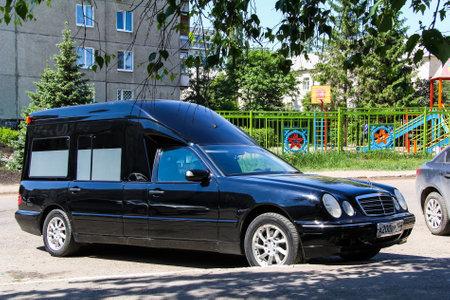hearse: UFA, RUSSIA - MAY 17, 2012: Black hearse car Mercedes-Benz W210 E-class in the city street.