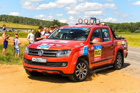 CHELYABINSK REGION, RUSSIA - JULY 11, 2016: Assistance truck Volkswagen Amarok No. R02 takes part in the annual Rally Silkway - Dakar Series.