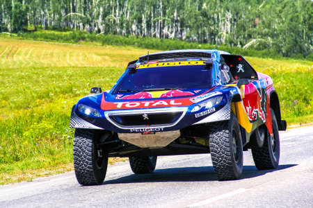proto: CHELYABINSK REGION, RUSSIA - JULY 11, 2016: Sportscar Peugeot 2008 DKR No. 100 of the Team Peugeot Total driven by Stephane Peterhansel takes part in the annual Rally Silkway - Dakar Series. Editorial