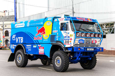 outside machines: MOSCOW, RUSSIA - JULY 7, 2012: Anton Shibalovs KAMAZ 4326 No. 310 of the Team Kamaz Master in the city street during the annual Silkway Rally - Dakar series.