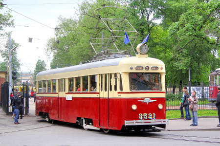 tramcar: SAINT PETERSBURG, RUSSIA - MAY 26: Vintage russian tramway LM-47 takes part at the Retro Urban Transport Parade on May 26, 2013 in Saint Petersburg, Russia.
