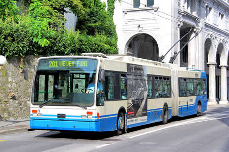 trackless: MONTREUX, SWITZERLAND - AUGUST 6, 2014: Articulated trolleybus Van Hool AG300T at the city street.