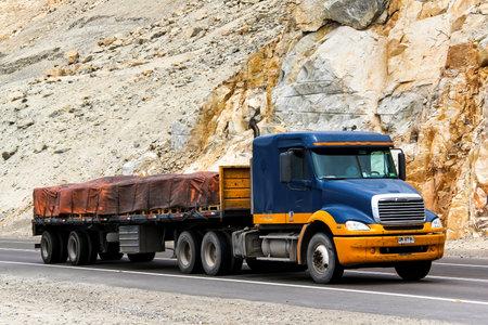 freightliner: ATACAMA, CHILE - NOVEMBER 14, 2015: Semi-trailer truck Freightliner Columbia at the interurban road.