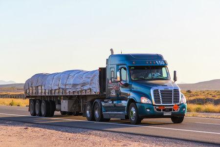 flatbed truck: ATACAMA, CHILE - NOVEMBER 13, 2015: Semi-trailer truck Freightliner Cascadia at the interurban freeway.