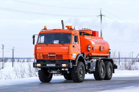 cisterna: NOVYY URENGOY, RUSSIA - FEBRUARY 14, 2015: Industrial cistern truck Kamaz 43114 at the interurban road.