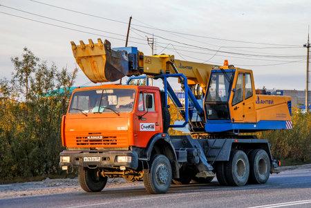 NOVYY URENGOY, RUSSIA - AUGUST 29, 2012: Mobile excavator Kamaz 65111 at the interurban road. Editorial