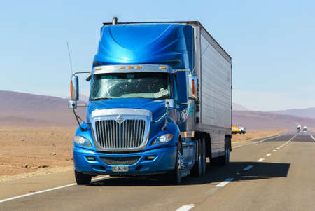 ATACAMA, CHILE - NOVEMBER 14, 2015: Semi-trailer truck International Navistar at the interurban freeway.
