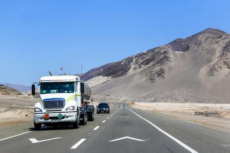 freightliner: ATACAMA, CHILE - NOVEMBER 14, 2015: Semi-trailer truck Freightliner Columbia at the road through the Atacama desert (Ruta del Desierto).