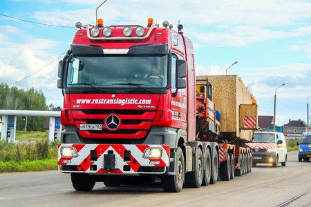 CHELYABINSK REGION, RUSSIA - AUGUST 29, 2013: Heavy trailer truck Mercedes-Benz Actros at the interurban road.