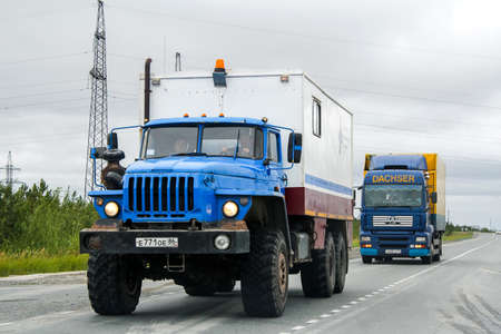 researches: YAMAL, RUSSIA - AUGUST 5, 2012: Geophysics researches truck Ural 4320 at the interurban road. Editorial