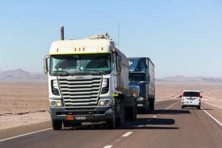 freightliner: ATACAMA, CHILE - NOVEMBER 18, 2015: Semi-trailer truck Freightliner Argosy at the interurban freeway.