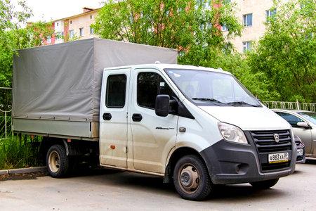 commercial tree service: NOVYY URENGOY, RUSSIA - JULY 8, 2014: White lorry GAZ Gazelle Next in the city street.