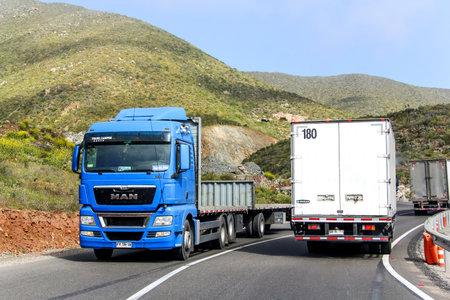 mountainous: ATACAMA, CHILE - NOVEMBER 13, 2015: Modern blue truck MAN TGX at the mountainous interurban freeway.