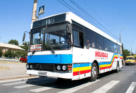 outside machines: VOLGOGRAD, RUSSIA - JULY 16, 2009: Urban bus Ajokki 8000 in the city street. Editorial